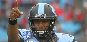 Marquise Williams points to the crowd as UNC defeated Cincinnati 39-17 in the Belk Bowl on Dec. 28, 2013 at Bank of America Stadium in Charlotte, N.C.