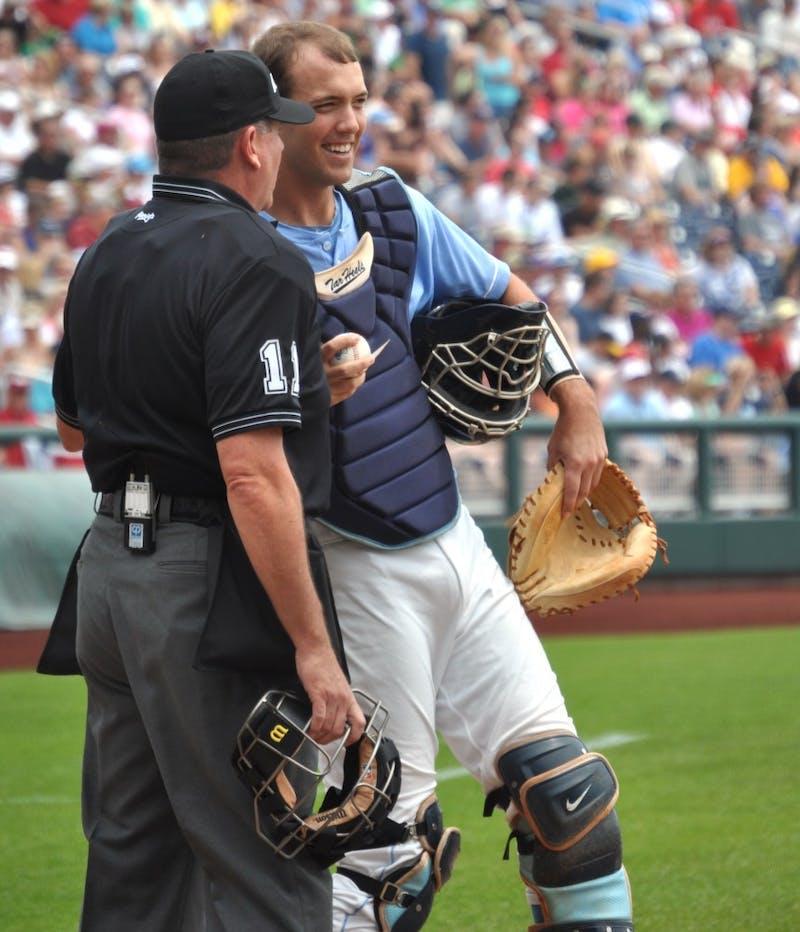 Junior catcher Jacob Stallings talks to the umpire before warming up for Carolina's College World Series opener against Vanderbilt.