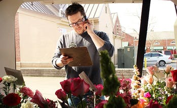 Stephen Cosoli from University Florist on East Franklin Street makes deliveries on Valentines day