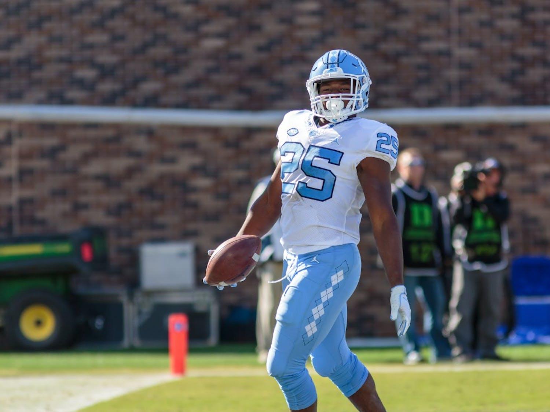 Running back Javonte Williams (25) celebratesa touchdown against Duke at Wallace Wade Stadium on Nov. 10, 2018.