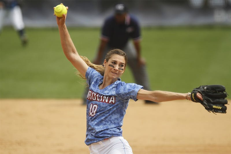 UNC pitcher, Lori Spingola, winds up a pitch against a Maryland opponent.  The Tar Heels defeated the Terps 11-5 in the first game of their double-header Saturday.