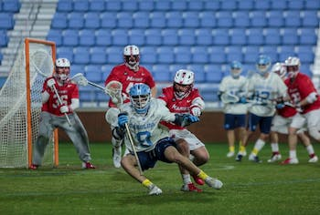UNC attackman Jacob Kelly (9) defends the ball during the home lacrosse game on Friday, March 8 2019 in the UNC Lacrosse Stadium. Kelly scored two goals during the game, helping the Tar Heels to a 17-5 victory over the Red Foxes.