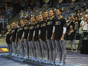 The North Carolina gymnastics team stands together wearing #BeTrue shirts in support of the LGBTQ+ community before a meet against Florida on Jan. 20, 2017.