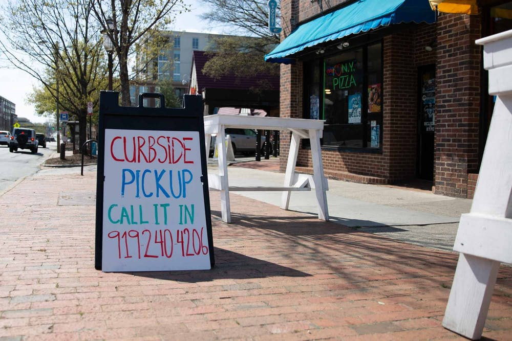 <p>A sign advertising curbside pickup stands outside the Trolly Stop on Friday, March 20, 2020. &nbsp;All restaurants were forced to stop dining in services and are open only for pick up or deliveries to stop the spread of COVID-19. &nbsp;</p>