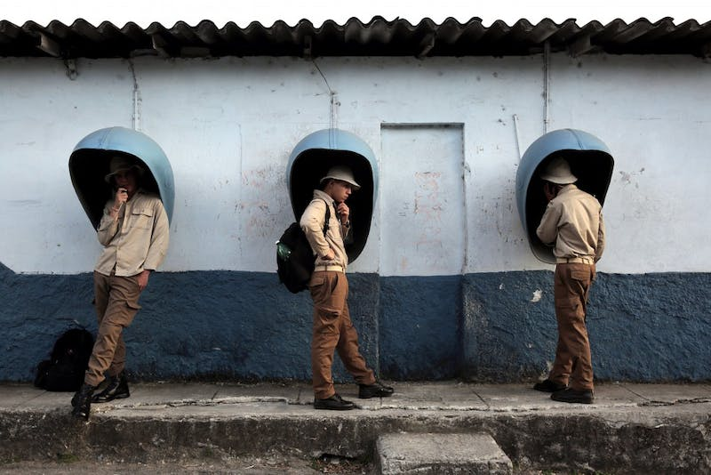 Cuban boys use payphones March 10, 2017, in the Regla district of Havana, Cuba. By Veasey Conway '18 MA.