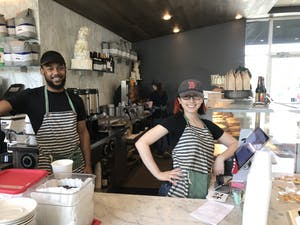 Michael Teasley (left) and Deb Aronin (right), both employees of Mad Hatter's Cafe and Bakeshop in Durham, say their job is to deliver smiles to all the customers. Mad Hatter's is expanding to Chapel Hill and hopes to open a new location on South Campus during the summer of 2019.