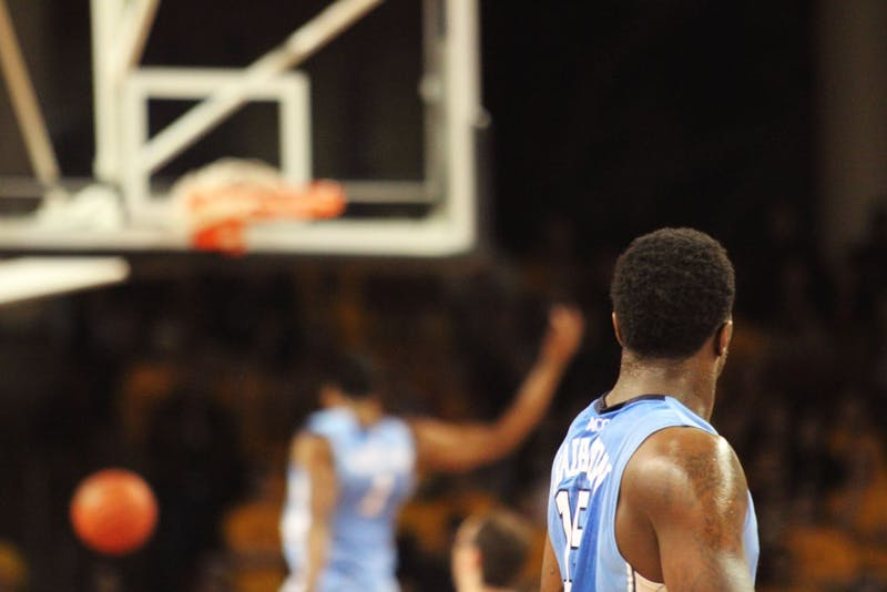 Hairston watches as Dexter Strickland finishes a dunk in the first half.