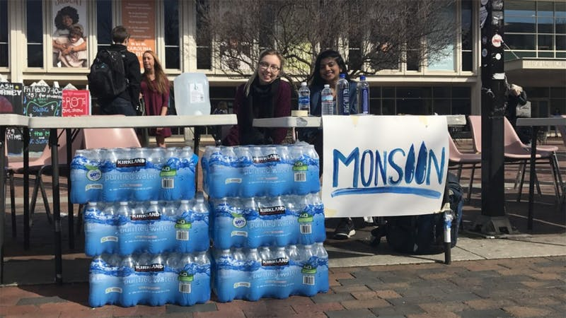 (From left) JuniorsAllory Vors and Shilpa Kancharla collect water bottles on behalf of Monsoon to be sent to Flint, Mich., for relief.