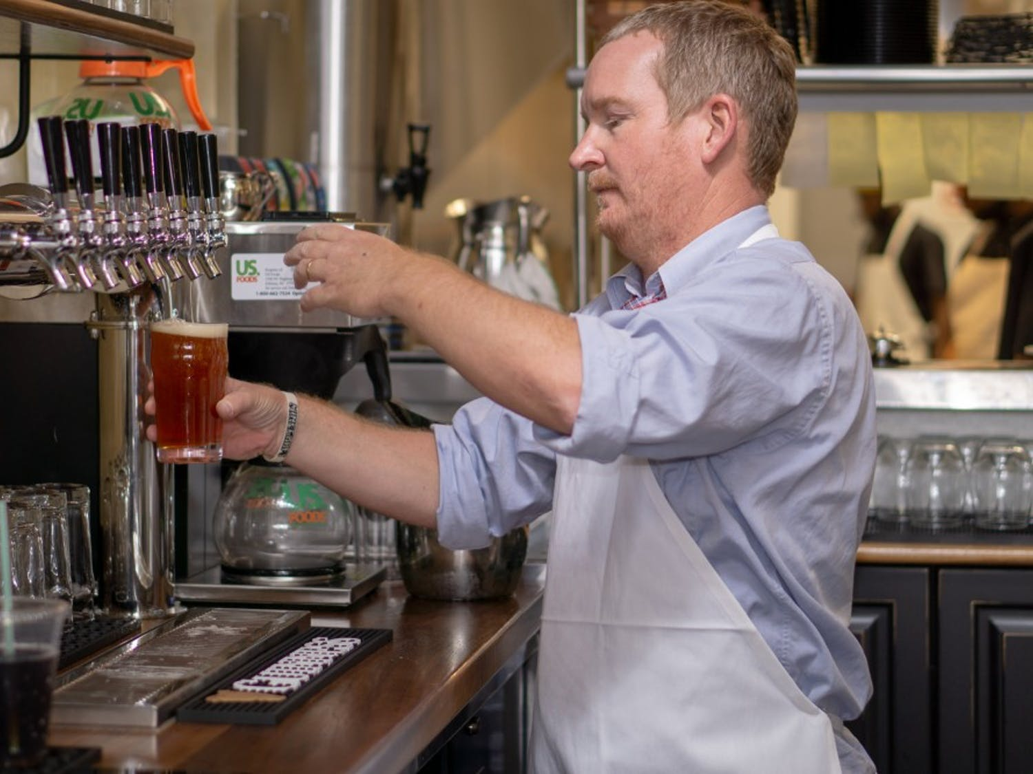 Award winning bartender Wayne Jordan pours from the tap at Al's Pub Shack.  Now open to the public Al's Pub Shack is located at 50050 Governors Drive Chapel Hill, N.C.
