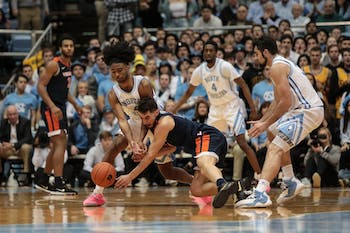 UNC first-year guard Coby White (2) fights for an open ball against UVA junior guard Ty Jerome (11) during the Tar Heels' 69-91 loss against UVA on Monday, Feb. 11, 2019 in the Smith Center in Chapel Hill, NC. White finished the night with 17 points for the Tar Heels.