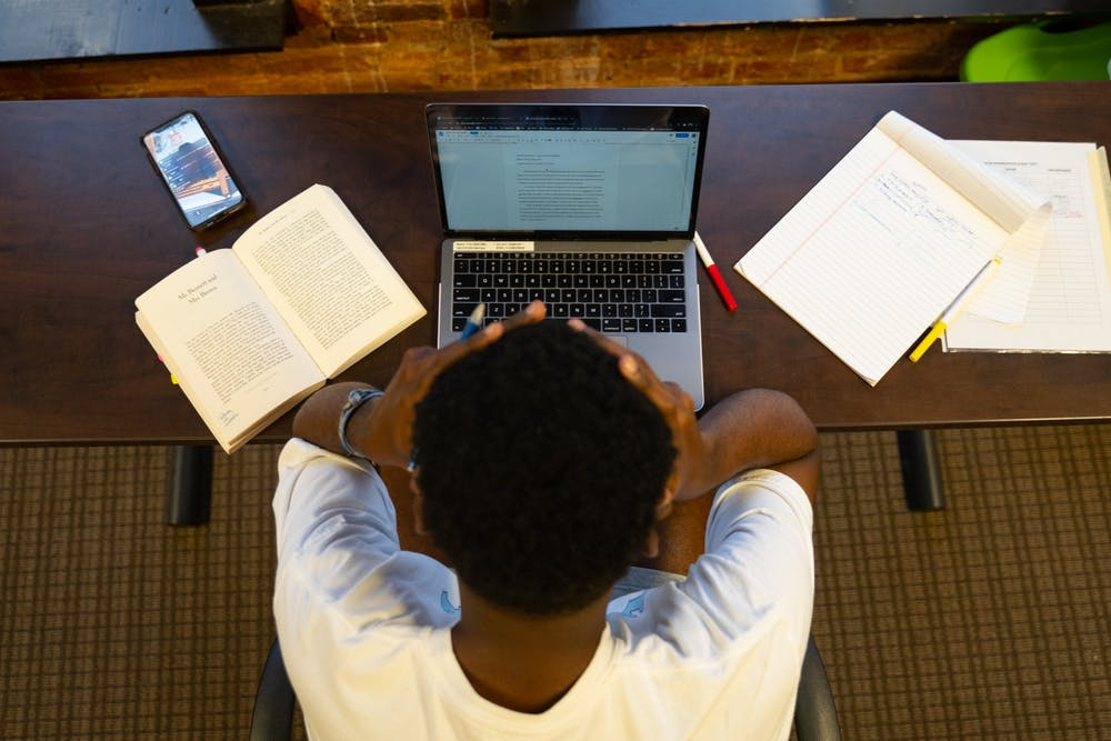 <p>DTH Photo Illustration. With online classes forcing unfamiliar working habits and adding a new level of stress, UNC hopes a switch to a pass/fail option for all undergraduate classes will ease that stress.</p>