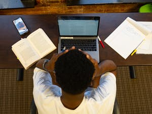 DTH Photo Illustration. With online classes forcing unfamiliar working habits and adding a new level of stress, UNC hopes a switch to a pass/fail option for all undergraduate classes will ease that stress.