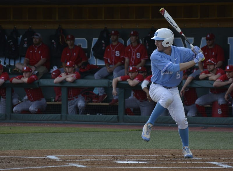 Brian Miller, UNC Junior 1st Baseman, prepares to swing at a pitch. The North Carolina Tar Heels defeated NC State University in their first of three baseball games on Friday, April 14, 2017. The Tar Heels won 7-2.