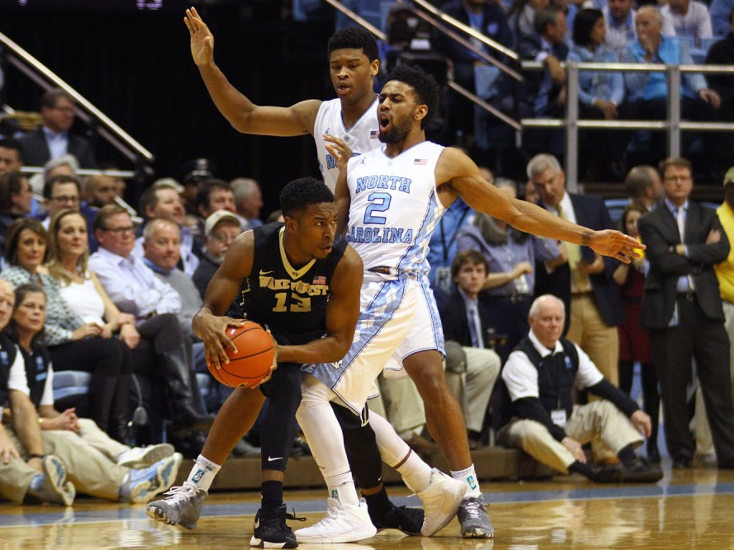 Freshman guard Bryant Crawford (13) is double-teamed by Joel Berry (2) and Isaiah Hicks (4) during Wednesday night's game in Chapel Hill.