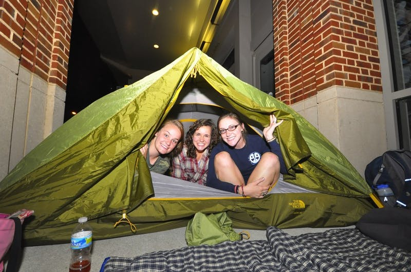 Juniors Sarah Kaminer and Amanda Srsic and freshman Molly Williams started waiting in line for Obama tickets at 10pm Saturday night. The box office opened an hour early to students and the public.