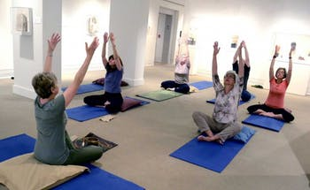 Yoga in the Galleries takes place at the Ackland on Monday afternoons. Photo courtesy of Allison Lathrop.