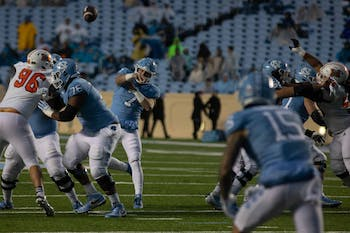 First-year quarterback Sam Howell (7) throws the ball down the field in Kenan Memorial Stadium on Saturday Nov. 23, 2019. UNC beat Mercer 56-7.