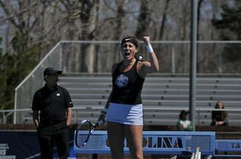 Junior Alexa Graham cheers after earning a point at the UNC women's tennis match against Miami on Sunday, March 24, 2019 at the Cone-Kenfield Tennis Center. UNC won 4-3. Graham earned the winning point for UNC.