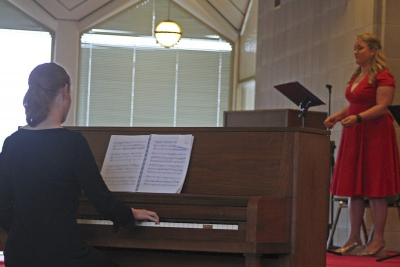 """Julia Carey (left) plays piano for """"The Body Politic"""" as Kristin Schwecke (right) performs the role of Constance."""