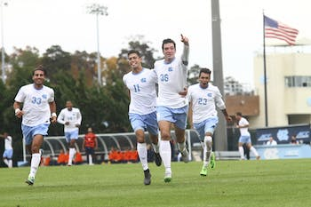 The Tar Heels celebrate after Tucker Hume (36) scored against Syracuse Sunday afternoon in the quarterfinals of the ACC tournament.