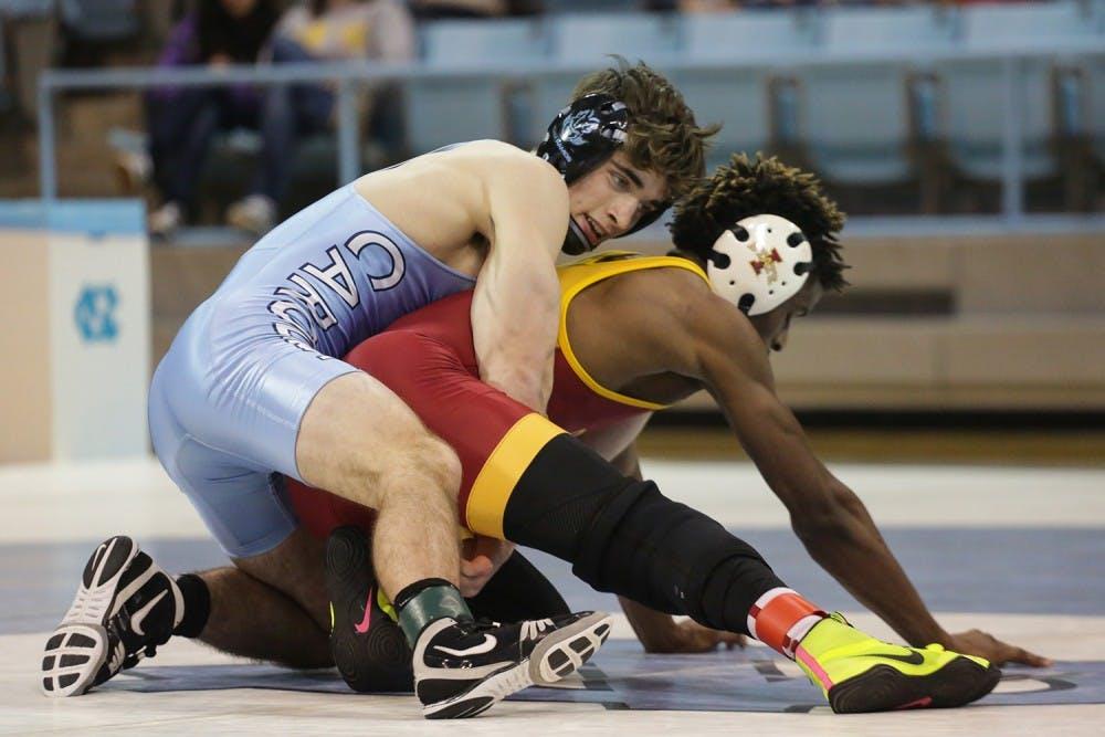 James Szymanski's late upset seals climactic win for UNC wrestling over Iowa State