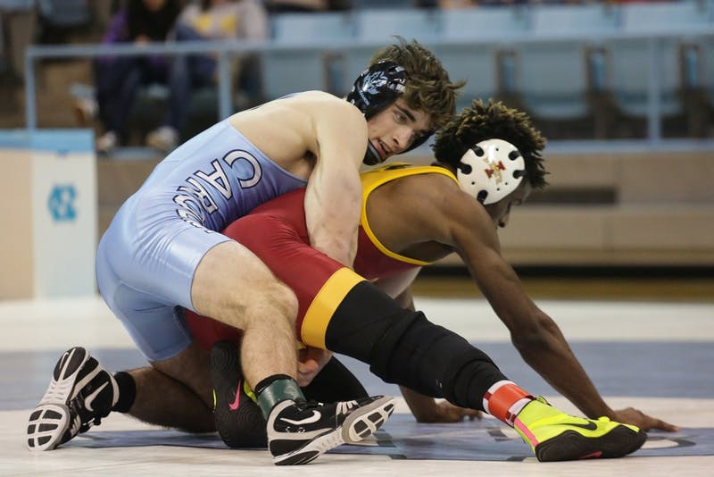 UNC wrestler James Szymanski (125) fights to break the tie between UNC and Iowa State Saturday night.