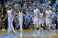 The North Carolina men's basketball team walks off the court after losing to Miami on a buzzer-beating three on Feb. 27 at the Smith Center.