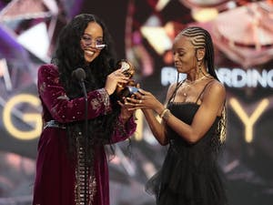 Los Angeles, CA, Sunday, March 14, 2021 - H.E.R. and Tiara Thomas accepts the award for Song Of The Year at the 63rd Grammy Award outside Staples Center. Photo courtesy of Robert Gauthier/Los Angeles Times.