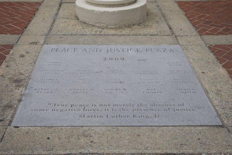 The Peace and Justice Plaza added two new names to the plaque outside of the post office on Franklin St.
