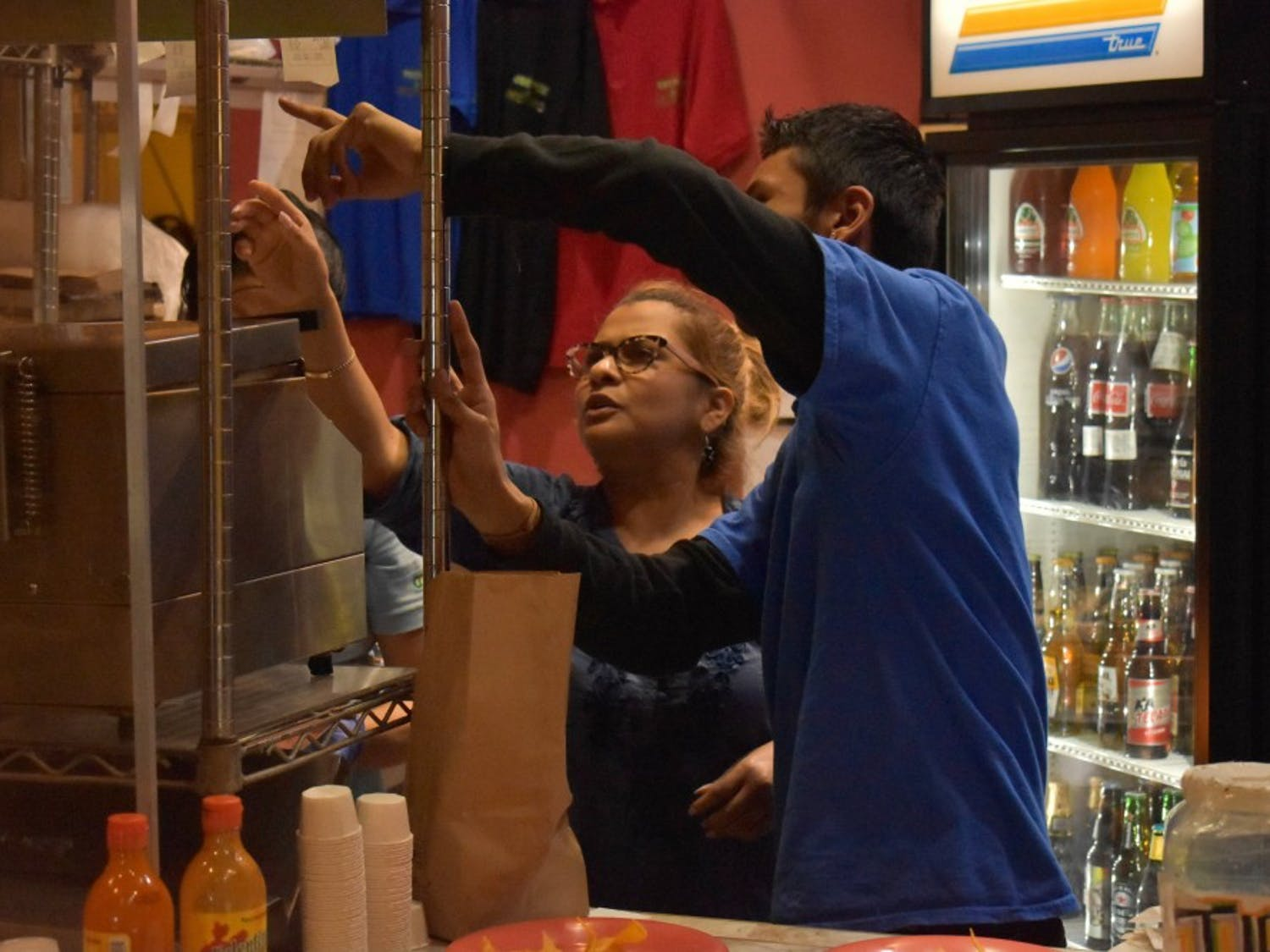 Cosmic employees Ismael Martinez and Argelia Cisneros work hard to prepare food for their loyal customers.
