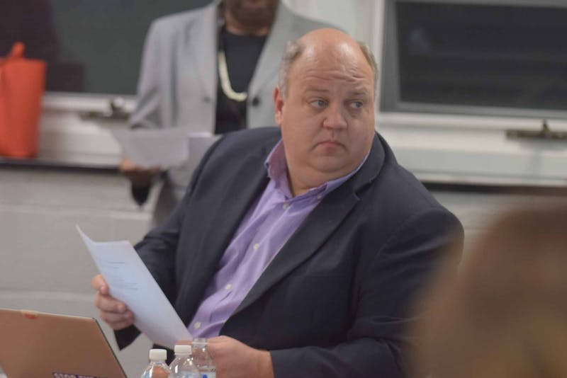 James Barrett, a member of the school board of Chapel Hill-Carrboro schools, sits in the school district meeting on Friday, Feb. 7, 2019 at the Lincoln Center, 750 S. Merritt Mill Rd.