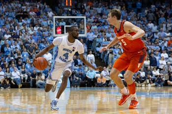 UNC senior guard Brandon Robinson (4) runs down the court as Clemson sophomore forward Hunter Tyson (5) at the Dean Smith Center on Saturday Jan. 11, 2020. UNC lost to Clemson 79-76, ending the Tigers 0-59 losing streak in Chapel Hill.