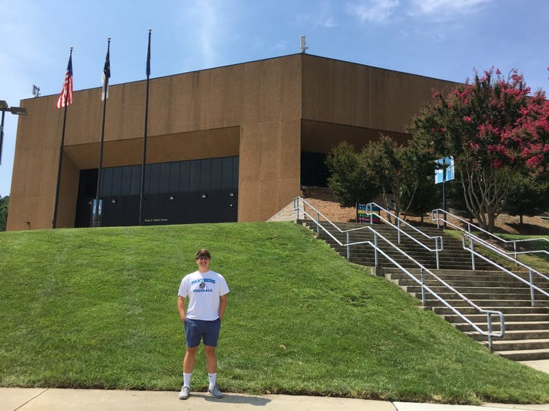 Sophomore journalism major David Brewer stands in front of the Smith Center.