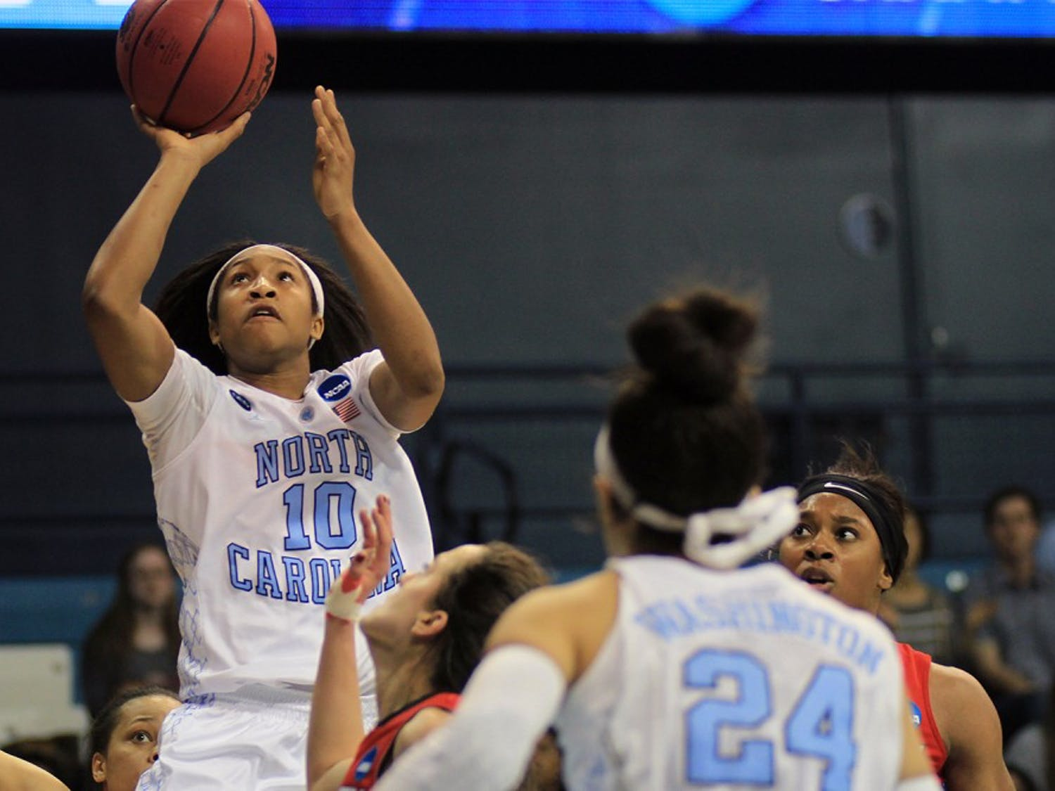 North Carolina senior guardDanielle Butts (10) takes a shot in the second half. Butts scored four points Saturday afternoon in Carmichael Arena.