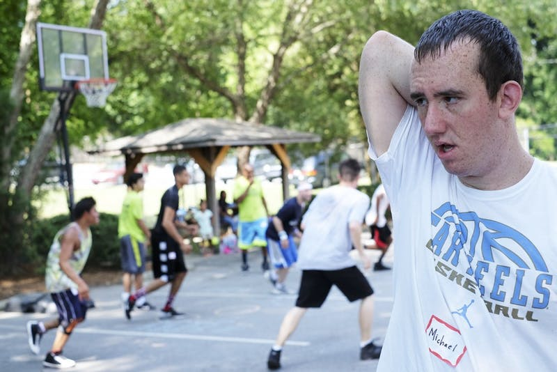 Michael Nager stands on the sideline after playing basketball at Extraordinary Ventures.