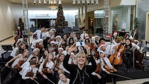 A group of eight graders from Phillips Middle School are pictured at their holiday performance at University Place in Chapel Hill in Dec. 2019. Photo courtesy of Ann Daaleman.
