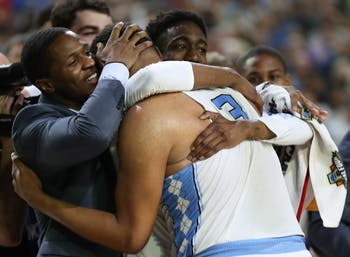 North Carolina forward Kennedy Meeks (3) is embraced by guards Kenny Williams and Brandon Robinson after recording 25 points and 14 rebounds against Oregon in the teams' Final Four matchup on Saturday in Phoenix.