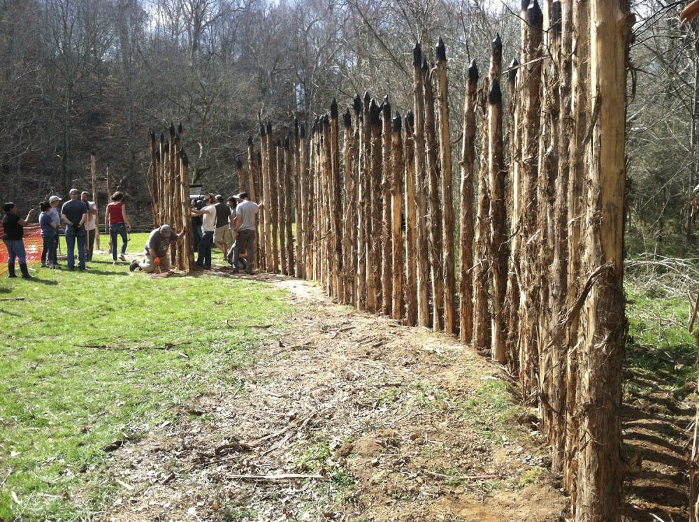 <p>Volunteers help raise 100 cedar poles this past Saturday at the new Occaneechi Band of the Saponi Nation Replica Village in Hillsborough. 400 cedar poles will eventually surround the site by this summer. Photo Courtesy of Holly Reid.</p>