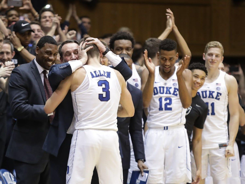 Duke head coach Mike Krzyzewski embraces senior guard Grayson Allen (3) after Allen played his final game at Cameron Indoor Stadium on March 3.