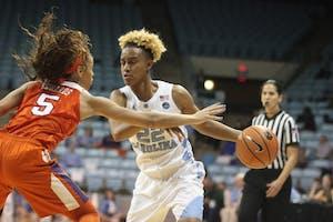 Guard Paris Kea (22) drives to the basket against Clemson on Thursday night in Carmichael Arena.