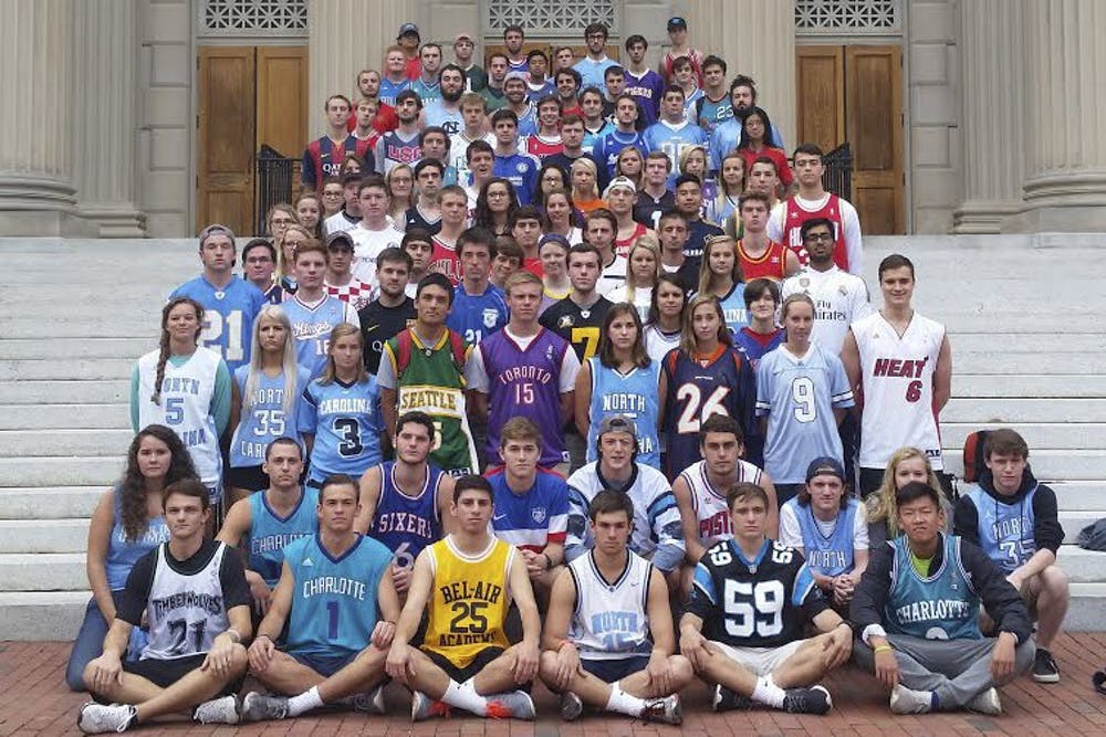 <p>Students meet on Thursdays outside Wilson Library to celebrate Jersday by wearing sports jerseys.</p>