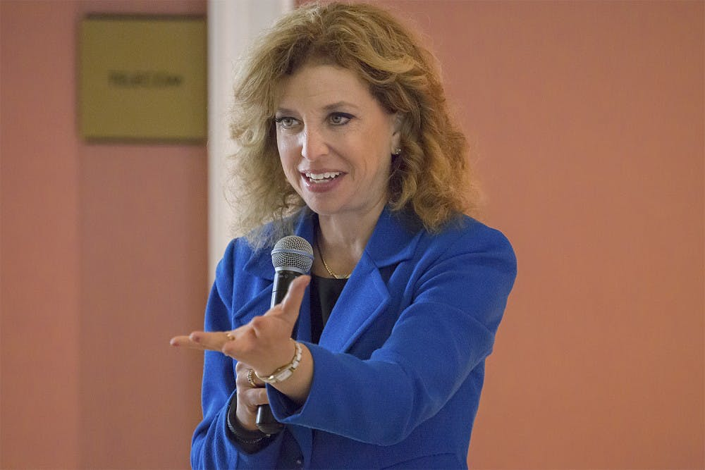 DNC leader Debbie Schultz rallies students