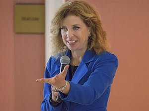 Rep. Debbie Wasserman Schultz (D-FL), chairwoman of the Democratic National Committee, encourages UNC students, who gathered to hear her speak in Gerrard Hall Monday, to re-elect Sen. Kay Hagan in next month's midterm elections.