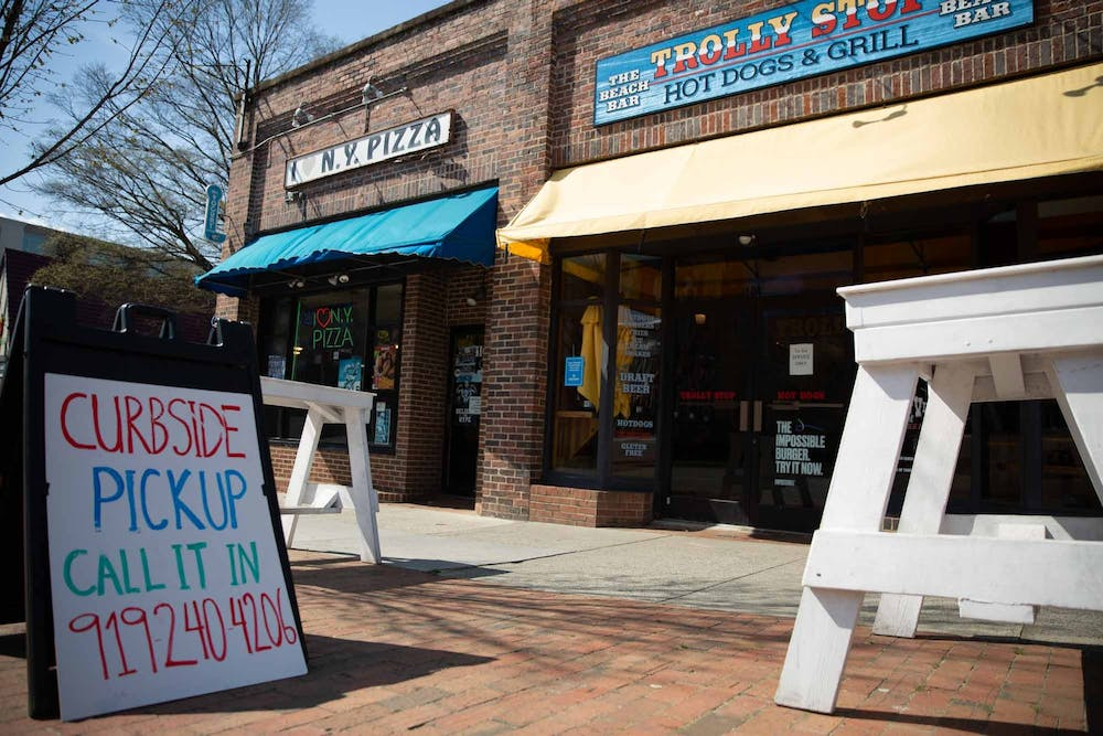 <p>A sign advertising curbside pickup stands outside the Trolly Stop on Friday, March 20, 2020. &nbsp;All restaurants were forced to stop dining in services and are open only for pick up or deliveries to stop the spread of COVID-19.&nbsp;</p>