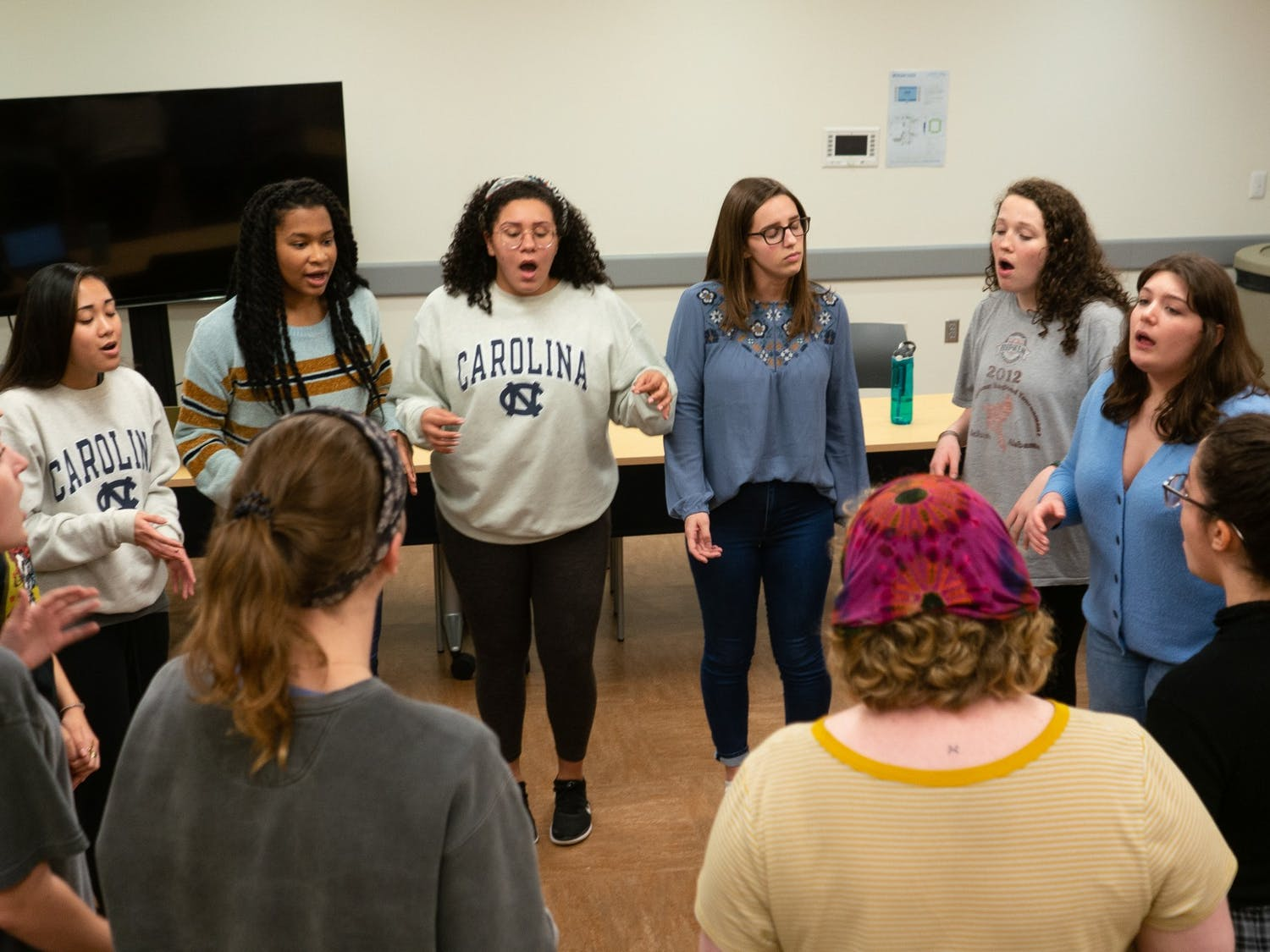 """Members of UNC's all-female-identifying a cappella group """"Cadence"""" rehearse """"The Way I Do"""" by Bishop Briggs in the Student Union on Wednesday, Feb. 5, 2020."""