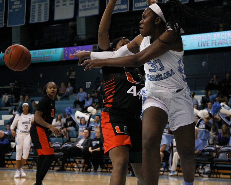 UNC junior center Janelle Bailey (30) passes the ball to a teammate during the Tar Heels' 78-58 victory over the Miami Hurricanes on Thursday, Jan. 16, 2020 at Carmichael Arena. Bailey finished the game with 28 points and 15 rebounds.