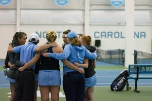The North Carolina women's tennis team huddles before its match against Boston College in the Cone-Kenfield Tennis Center on March 2.