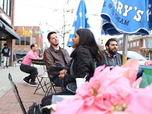 The Chapel Hill Town Planning Commission is considering changing the sidewalk dining ordinance to expand seating. Adam James, David Alki, and Aditi Patel sit outside of Ben and Jerry's on Franklin Street Thursday, March 21, 2019.