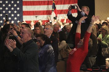 Supporters of Thom Tillis celebrate his victory for North Carolina's U.S. Senate seat at his election party in the Omni Hotel in Charlotte Tuesday.