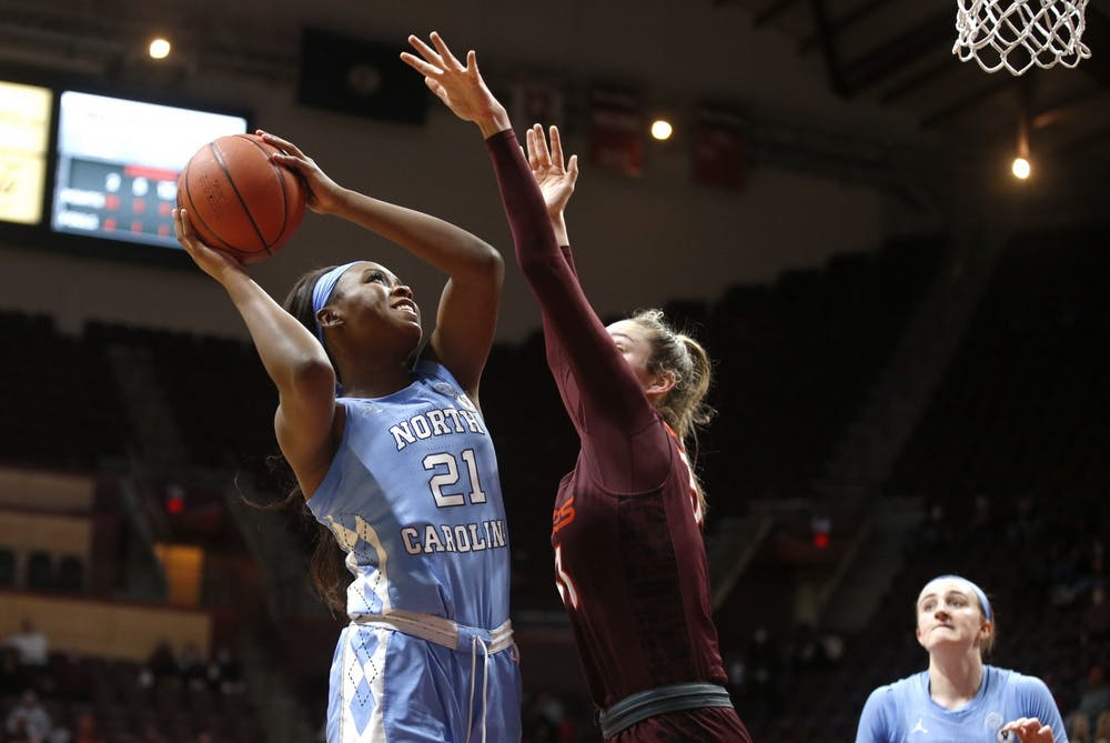 UNC's sophomore forward Malu Tshitenge (21) attempts a layup during a game against Virginia Tech on Sunday, Jan. 31, 2021. UNC fell to VT 69-73. Photo courtesy of Jon Fleming.